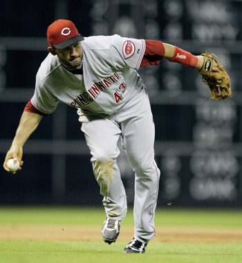 HOUSTON - JULY 23:  Third baseman Miguel Cairo #43 of the Cincinnati Reds makes a play on a slow roller against the Houston Astros at Minute Maid Park on July 23, 2010 in Houston, Texas.  (Photo by Bob Levey/Getty Images)