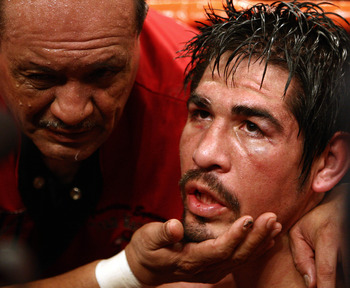 LOS ANGELES - JANUARY 24:   Antonio Margarito sits dazed in his corner after Shane Mosley's ninth round TKO after Margarito's corner threw in the towel during their WBA welterweight title fight on January 24, 2009 at the Staples Center in Los Angeles, Cal