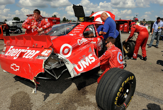 INDIANAPOLIS - JULY 25:  Crew members work on the #42 Target Chevrolet driven by Juan Pablo Montoya after it crashed late in the race during the NASCAR Sprint Cup Series Brickyard 400 at Indianapolis Motor Speedway on July 25, 2010 in Indianapolis, Indian
