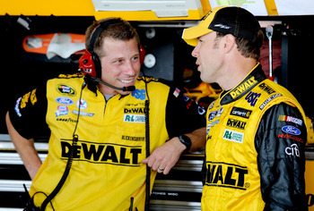 RICHMOND, VA - SEPTEMBER 11:  Matt Kenseth, driver of the #17 Dewalt Ford, stands with his crew chief Drew Blickensderfer, in the garage area during practice for the NASCAR Sprint Cup Series Chevy Rock & Roll 400 at Richmond International Raceway on Septe