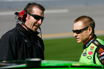 DAYTONA BEACH, FL - FEBRUARY 06:  Mark Martin, driver of the #5 GoDaddy.com Chevrolet, talks with crew chief Alan Gustafson on pit road during qualifying for the Daytona 500 at Daytona International Speedway on February 6, 2010 in Daytona Beach, Florida.