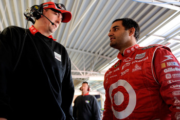KANSAS CITY, KS - OCTOBER 02:  Juan Pablo Montoya (r), driver of the #42 Target Chevrolet, speaks with crew chief Brian Pattie (l), during practice for the NASCAR Sprint Cup Series Price Chopper 400 presented by Kraft Foods at the Kansas Speedway on Octob