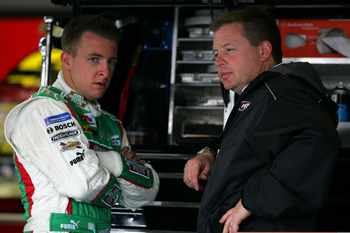 TALLADEGA, AL - OCTOBER 30:  AJ Allmendinger (L), driver of the #44 Hunt Brothers Pizza Dodge, talks with his crew chief Mike Shiplett in the garage prior to practice for the NASCAR Sprint Cup Series AMP Energy 500 at Talladega Superspeedway on October 30
