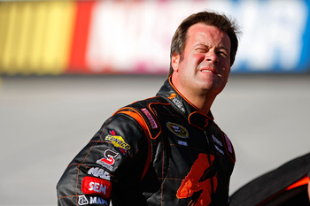BRISTOL, TN - AUGUST 20:  Robby Gordon, driver of the #07 SpeedFactory.TV Toyota, stands on the grid during qualifying for the NASCAR Sprint Cup Series IRWIN Tools Night Race at Bristol Motor Speedway on August 20, 2010 in Bristol, Tennessee.  (Photo by G