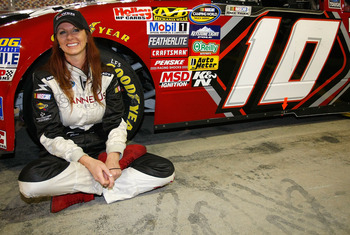 CONCORD, NC - MAY 21: Jennifer Jo Cobb, driver of the #10 DrivenMale.com Ford, sits on the grid prior to the NASCAR Camping World Truck Series North Carolina Education Lottery 200 at Charlotte Motor Speedway on May 21, 2010 in Concord, North Carolina.  (P