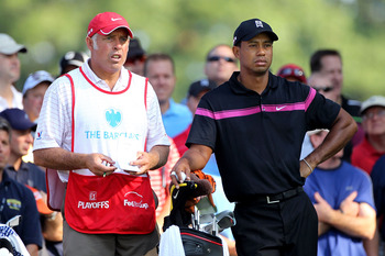 PARAMUS, NJ - AUGUST 26:  Tiger Woods (R) and his caddie Steve Williams look on from the tenth hole tee box during the first round of The Barclays at the Ridgewood Country Club on August 26, 2010 in Paramus, New Jersey.  (Photo by Hunter Martin/Getty Imag