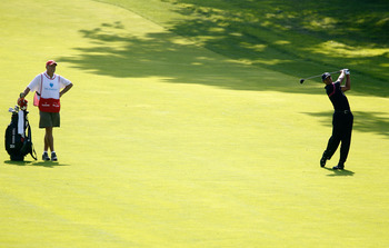 PARAMUS, NJ - AUGUST 26:  Tiger Woods watches his shot from the fairway on the 13th hole along with caddie Steve Williams during the first round of The Barclays at the Ridgewood Country Club on August 26, 2010 in Paramus, New Jersey.  (Photo by Scott Hall