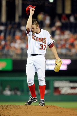 WASHINGTON - AUGUST 10:  Stephen Strasburg #37 of the Washington Nationals wipes his forehead during the game against the Florida Marlins at Nationals Park on August 10, 2010 in Washington, DC.  (Photo by Greg Fiume/Getty Images)