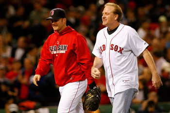 BOSTON - OCTOBER 16:  Curt Schilling of the Boston Red Sox is greeted by David Ross after throwing out the first pitch of game five of the American League Championship Series against the Tampa Bay Rays during the 2008 MLB playoffs at Fenway Park on Octobe