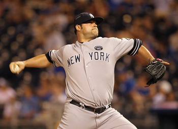 KANSAS CITY, MO - AUGUST 13:  Pitcher Joba Chamberlain #62 of the New York Yankees pitches during the game against the Kansas City Royals on August 13, 2010 at Kauffman Stadium in Kansas City, Missouri.  (Photo by Jamie Squire/Getty Images)