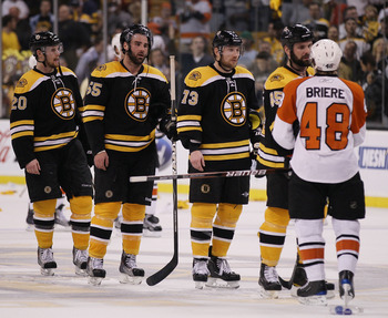 BOSTON - MAY 14:  Mark Stuart #45, Michael Ryder #73, Johnny Boychuk #55 and Daniel Paille #20 of the Boston Bruins congratulate Danny Briere #48 of the Philadelphia Flyers in Game Seven of the Eastern Conference Semifinals during the 2010 NHL Stanley Cup