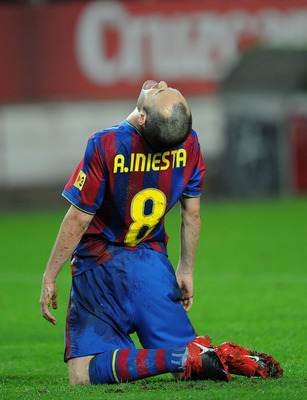 SEVILLE, SPAIN - JANUARY 13:  Andres Iniesta of Barcelona reacts during the last 16 second leg Copa del Rey match between Barcelona and Sevilla at the Ramon Sanchez Pizjuan stadium on January 13, 2010 in Seville, Spain.  (Photo by Denis Doyle/Getty Images
