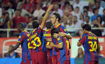SEVILLE, SPAIN - AUGUST 14:  : Zlatan Ibrahimovic (C) of Barcelona celebrates with teammates after scoring a goal during the Supercopa, first leg, match between Sevilla and Barcelona at the Sanchez Pizjuan stadium  on August 14, 2010 in Seville, Spain.  (