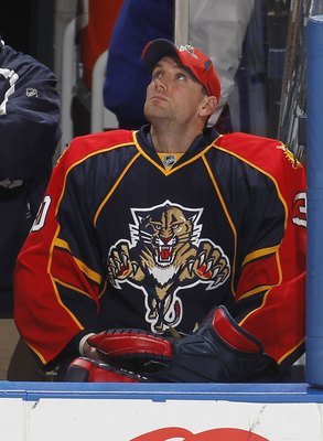 SUNRISE, FL - APRIL 6: Goaltender Scott Clemmensen #30 of the Florida Panthers watches a replay of an Ottawa Senators goal during the third period on April 6, 2010 at the BankAtlantic Center in Sunrise, Florida. The Senators defeated the Panthers 5-2. (Ph