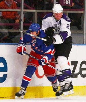 NEW YORK - OCTOBER 14: Matt Greene #2 of the Los Angeles Kings hits Brandon Dubinsky #17 of the New York Rangers at Madison Square Garden on October 14, 2009 in New York, New York. (Photo by Bruce Bennett/Getty Images)