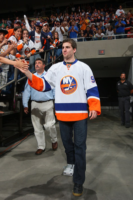 UNIONDALE, NY - JUNE 25:  John Tavares # 91 of the New York Islanders is introduced wearing the new 2010-2011 road jersey during the New York Islanders Draft Day Party on June 25, 2010 at Nassau Coliseum in Uniondale, New York.  (Photo by Mike Stobe/Getty
