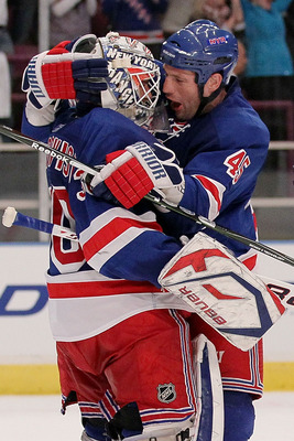 NEW YORK - APRIL 09: Henrik Lundqvist #30 of the New York Rangers celebrates victory with team mate Jody Shelley #45 against the Philadelphia Flyers during their game on April 9, 2010 at Madison Square Garden in New York City.  (Photo by Chris McGrath/Get