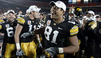 Iowa Hawkeyes celebrating victory in Orange Bowl.
