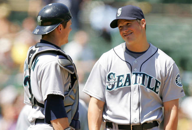 OAKLAND, CA - MAY 27:  Erik Bedard #45 of the Seattle Mariners talks to catcher Rob Johnson #32 before he is taken out of their game against the Oakland Athletics at the Oakland Coliseum on May 27, 2009 in Oakland, California.  (Photo by Ezra Shaw/Getty I