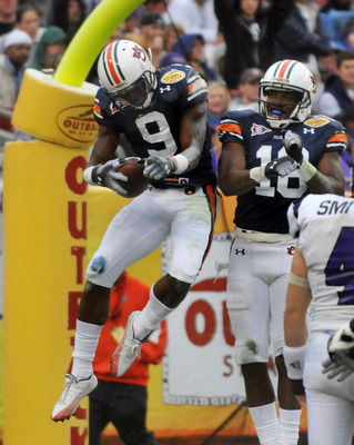 TAMPA, FL - JANUARY 1: Wide receiver Quindarius Carr #9 of the Auburn Tigers celebrates a touchdown against the Northwestern Wildcats in the Outback Bowl January 1, 2010 at Raymond James Stadium in Tampa, Florida.  (Photo by Al Messerschmidt/Getty Images)
