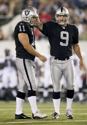 CANTON, OH - AUGUST 6: Place kicker Sebastian Janikowski #11 of the Oakland Raiders is congratulated by holder Shane Lechler #9 after Janikowskit kicked a 51-yard field goal in the third quarter against the Philadelphia Eagles in the AFC-NFC Pro Football