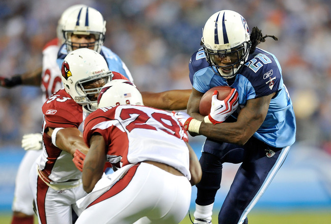 NASHVILLE, TN - AUGUST 23:  Chris Johnson #28 of the Tennessee Titans avoids defenders Clark Haggans #53 and Dominique Rogers-Cromartie #29 of te Arizona Cardinals during the first half of a preseason game at LP Field on August 23, 2010 in Nashville, Tenn
