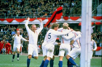 Undated:  Actor Michael Caine and England player Bobby Moore of the POW XI celebrate during a match against Germany for the film Escape to Victory.  \ Mandatory Credit: Allsport UK /Allsport