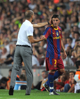 BARCELONA, SPAIN - AUGUST 25:  David Villa of Barcelona is congratulated by Barcelona manager Josep Guardiola after he was substituted during the Joan Gamper Trophy match between Barcelona and AC Milan at Camp Nou stadium on August 25, 2010 in Barcelona,