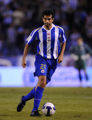 A CORUNA, SPAIN - AUGUST 14:  Juan Carlos Valeron of Deportivo La Coruna goes for the ball during the UEFA Cup Second Qualifying Round, first leg between Deportivo La Coruna and Hadjuk Split at the Riazor stadium on August 14, 2008 in A Coruna, Spain.  (P