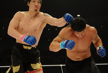 YOKOHAMA, JAPAN - MAY 26:  Former Oakland Athletics slugger Jose Canseco (R) is hit by Choi Hong-man at first Round of Super Hulk Tournament during Dream.9 at Yokohama Arena on May 26, 2009 in Yokohama, Kanagawa, Japan. Canseco lost at 1 minute 17 seconds