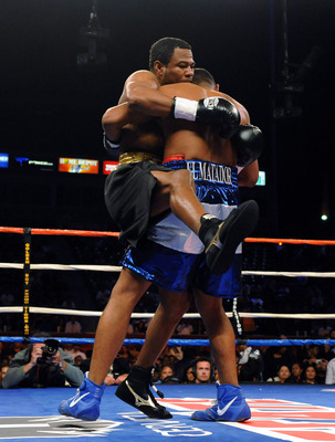 CARSON, CA - SEPTEMBER 27:  Shane Mosley is lifted up by Ricardo Mayorga of Nicaragua in the first round during their junior middleweight bout at the Home Depot Center on September 27, 2008 in Carson, California.  (Photo by Harry How/Getty Images)