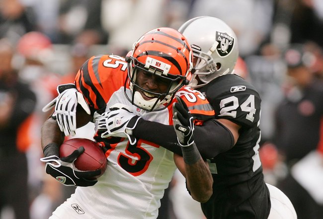 OAKLAND, CA - NOVEMBER 22:  Chad Ochocinco #85 of the Cincinnati Bengals is tackled by Michael Huff #24 of the Oakland Raiders at Oakland-Alameda County Coliseum on November 22, 2009 in Oakland, California.  (Photo by Ezra Shaw/Getty Images)