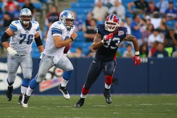 ORCHARD PARK, NY - SEPTEMBER 3:  Matthew Stafford #9 of the Detroit Lions scrambles against Chris Ellis #93 of the Buffalo Bills during the preseason game at Ralph Wilson Stadium on September 3, 2009 in Orchard Park, New York. (Photo by Rick Stewart/Getty