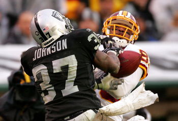 OAKLAND, CA - DECEMBER 13:  Chris Johnson #37 of the Oakland Raiders breaks up a pass intended for Santana Moss #89 of the Washington Redskins at Oakland-Alameda County Coliseum on December 13, 2009 in Oakland, California.  (Photo by Ezra Shaw/Getty Image