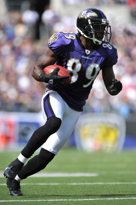BALTIMORE - SEPTEMBER 27:  Mark Clayton #89 of the Baltimore Ravens runs the ball against the Cleveland Browns at M&T Bank Stadium on September 27, 2009 in Baltimore, Maryland. The Ravens defeated the Browns 34-3. (Photo by Larry French/Getty Images)