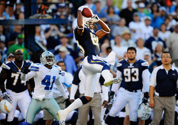 SAN DIEGO - AUGUST 21:  Wide receiver Malcolm Floyd #80 catches a pass against Terence Newman #41 of the Dallas Cowboys during their preseason NFL football game at Qualcomm Stadium on August 21, 2010 in San Diego, California.  (Photo by Kevork Djansezian/