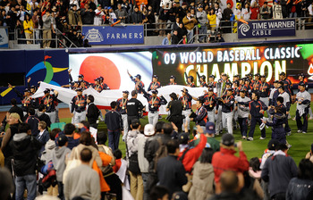 LOS ANGELES, CA - MARCH 23:  Japan players hold up their nation's flag after defeating Korea during the finals of the 2009 World Baseball Classic on March 23, 2009 at Dodger Stadium in Los Angeles, California. Japan won 5-3 in 10 innings.  (Photo by Kevor