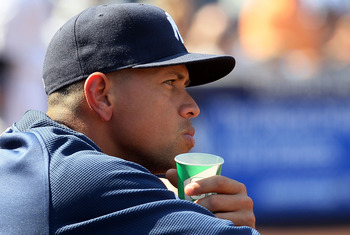 NEW YORK - AUGUST 19:  Alex Rodriguez #13 of the New York Yankees looks on from the dugout against the Detroit Tigers on August 19, 2010 at Yankee Stadium in the Bronx borough of New York City.  (Photo by Jim McIsaac/Getty Images)