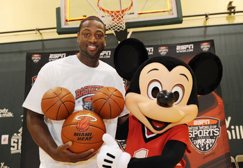LAKE BUENA VISTA, FL - JULY 11:  In this handout image provided by Walt Disney Studios, Miami Heat guard Dwyane Wade poses July 11, 2010 with a basketball-clad Mickey Mouse at the ESPN Wide World of Sports complex in Lake Buena Vista, Fla.  In honor of Wa