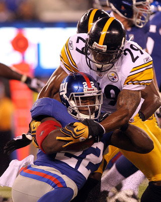 EAST RUTHERFORD, NJ - AUGUST 21: Andre Brown #22 of the New York Giants is tackled by Ryan Mundy #29 of the Pittsburgh Steelers during their preseason game at New Meadowlands Stadium on August 21, 2010 in East Rutherford, New Jersey.  (Photo by Nick Laham