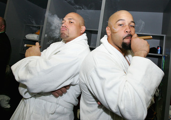 TAMPA, FL - FEBRUARY 01:  James Farrior #51 and Larry Foote #50 of the Pittsburgh Steelers celebrate with cigars in the locker room after defeating the Arizona Cardinals during Super Bowl XLIII on February 1, 2009 at Raymond James Stadium in Tampa, Florid