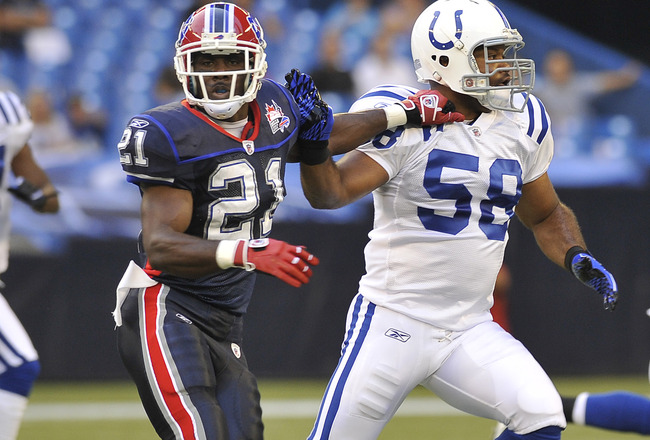 TORONTO, CANADA - AUGUST 19: C.J. Spiller #21 of the Buffalo Bills runs with Gary Brackett #58 of the Indianapolis Colts during game action August 19, 2010 at the Rogers Centre in Toronto, Ontario, Canada. (Photo by Brad White/Getty Images)