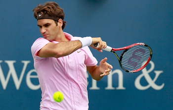 CINCINNATI - AUGUST 22:  Roger Federer of Switzerland returns a forehand to Mardy Fish during the finals on Day 7 of the Western &amp; Southern Financial Group Masters at the Lindner Family Tennis Center on August 22, 2010 in Cincinnati, Ohio.  (Photo by Kevi