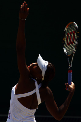 LONDON, ENGLAND - JUNE 28:  Venus Williams of USA serves during her match against Jarmila Groth of Australia on Day Seven of the Wimbledon Lawn Tennis Championships at the All England Lawn Tennis and Croquet Club on June 28, 2010 in London, England.  (Pho