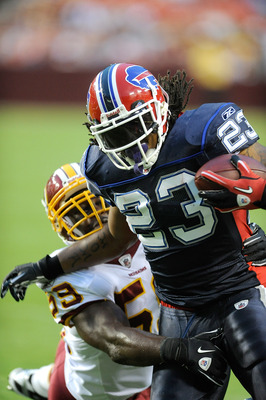 LANDOVER, MD - AUGUST 13:  Marshawn Lynch #23 of the Buffalo Bills is tackled during the preseason game by London Fletcher #59 of the Washington Redskins at FedEx Field on August 13, 2010 in Landover, Maryland.  (Photo by Greg Fiume/Getty Images)