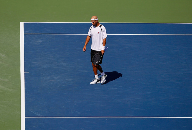 CINCINNATI - AUGUST 17:  James Blake walks to the service line in between games against Denis Istomin of Uzebekistan during Day 2 of the Western & Southern Financial Group Masters at the Lindner Family Tennis Center on August 17, 2010 in Cincinnati, Ohio.
