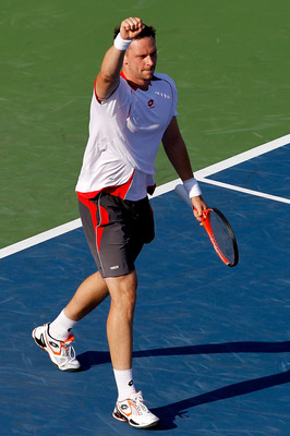 TORONTO, ON - AUGUST 10: Robin Soderling of Sweden celebrates match point against Ernests Gulbis of Latvia during the Rogers Cup at the Rexall Centre on August 10, 2010 in Toronto, Canada.  (Photo by Matthew Stockman/Getty Images)