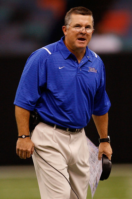 NEW ORLEANS - SEPTEMBER 04:  Head coach Todd Graham of the Tulsa Golden Hurricanes talks with his team during a timeout against the Tulane Green Wave at the Louisiana Superdome on September 4, 2009 in New Orleans, Louisiana.   The Hurricanes defeated the