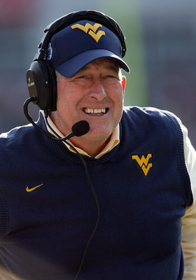 JACKSONVILLE, FL - JANUARY 01:  Head coach Bill Stewart of the West Virginia Mountaineers watches his team take on the Florida State Seminoles during the Konica Minolta Gator Bowl on January 1, 2010 at Jacksonville Municipal Stadium in Jacksonville, Flori