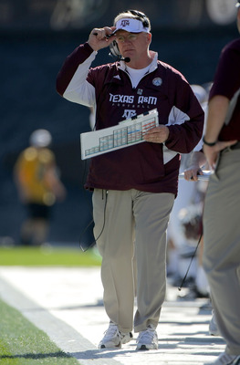 BOULDER, CO - NOVEMBER 07:  Head coach Mike Sherman of the Texas A&M Aggies leads his team against the Colorado Buffaloes during NCAA college football action at Folsom Field on November 7, 2009 in Boulder, Colorado. Colorado defeated Texas A&M 35-34.  (Ph